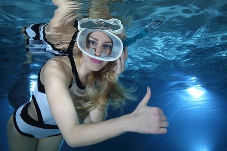 Happy female snorkeler hand signal