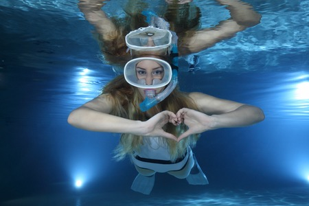 pool diving: Female snorkeler show heart signal