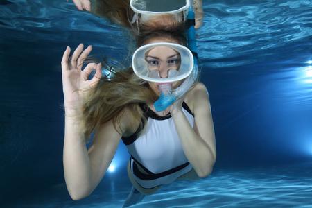 fun activity: Happy female snorkeler show signal Stock Photo