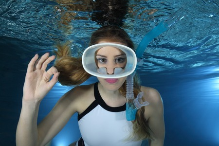 woman diving: Happy female snorkeler show signal Stock Photo