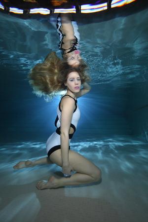 Beautiful woman underwater in the pool Stock Photo