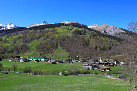 View to the village of Elm and the mineral water source, Glarus, Switzerland Imagens