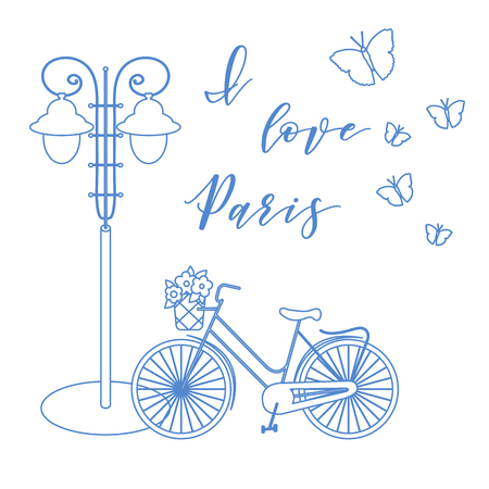 Bicycle with a basket of flowers, lantern, butterflies. The inscription I love Paris. Travel and leisure.