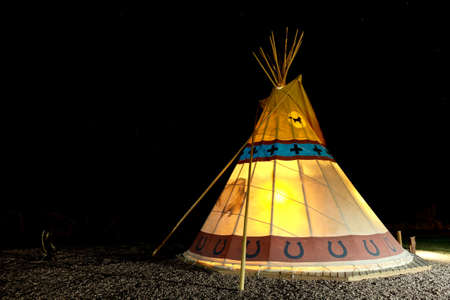 Camping at American First Nation Traditional Teepee at Night. Capitol Reef National Park, Utah, USA.