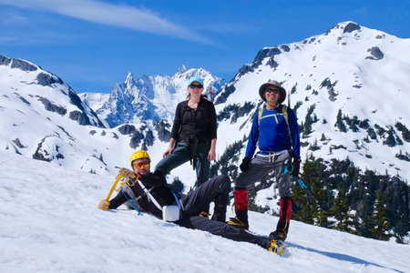 snowcovered: Group of happy friends climbers ascending Ruth Mountain near Bellingham, Norths Cascades National Park, Washington State, USA.