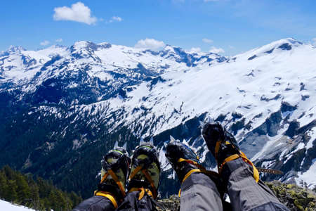 Climbers legs with boots and crampones  at Ruth Mountain, North Cascades National park, Mt. Baker wilderness, Washington State, USA. Stock Photo