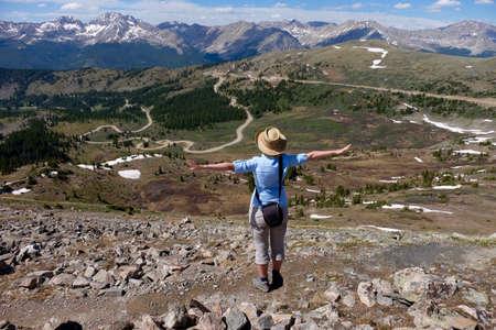 rocky mountains colorado: Woman standing enjoying mountains valley view. Cottonwood Pass near Buena Vista and Denver  in Rocky Mountains, Colorado, USA.