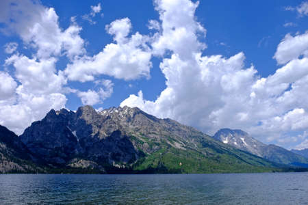 jenny: Impressive mountains and clouds by lake. Jenny lake in Grand Tetons National Park, Jackson, Moose, Wyoming. Stock Photo