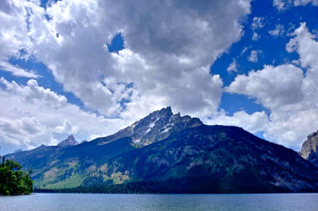 jackson: Impressive mountains and clouds by lake. Jenny Lake in Grand Tetons National park, Jackson, Wyoming.