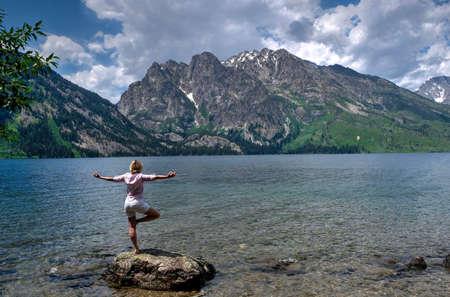 jenny: Woman exercising by lake and mountains. Jenny Lake in Grand Tetons National Park, Jackson, Wyoming.