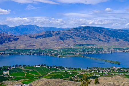 vinery: Orchards, vineyards, lake and mountains. Osoyoos, British Columbia, Canada. Stock Photo