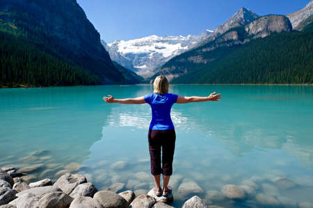 Woman traveling to Lake Louise in Rocky Mountains. Banff National Park. Alberta. Canada.