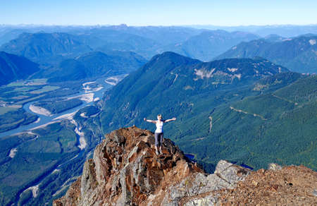 Successful woman on mountain top. Mount Chem near Harrison Hot Springs, British Columbia, Canada. Stock Photo