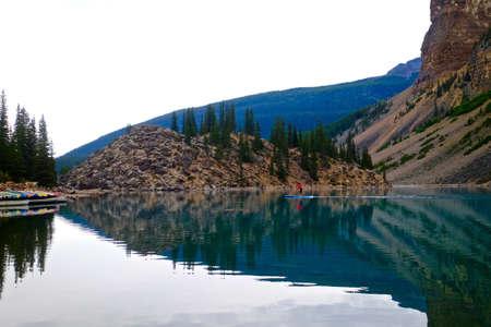 natue: Peaceful paddle boarding in alpine lake. Banff National Park, Alberta, Canada. Stock Photo