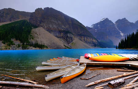 canadian rockies: Colorful boats in Alpine Lake. Canadian Rockies, Alberta, Canada.