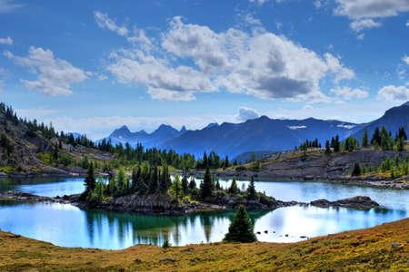banff national park: Island reflection in lake. Sunshine Meadows in Banff National Park. Rocky Mountains. Alberta. Canada.