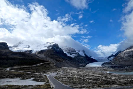 icefield: Glacier and clouds. Columbia Icefield. Rocky Mountains of North America. Canadian Rockies. Banff and Jasper National Park.