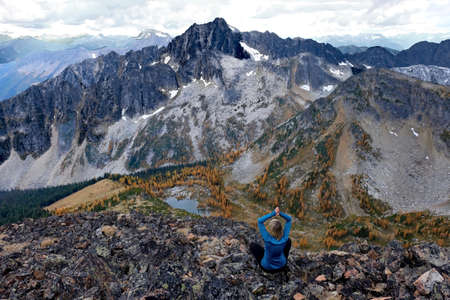 Woman meditating on Frosty Mountain. Manning Provincial Park. Hope. British Columbia. Canada. Stock Photo