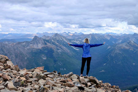 Woman on mountain top. Frosty Mountain. Manning Park. Hope. British Columbia. Canada. Reklamní fotografie