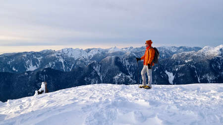 Man standing on mountain top. Mount Seymour Provincial Park. Vancouver. British Columbia. Canada.