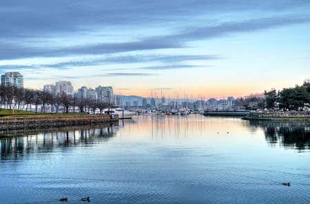 Sunset over harbor. False Creek from Granville Island. Yaletown. Vancouver. British Columbica. Canada.