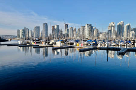 City and boats by water. Heather Civic Marina. Granville Bridge. Downtown Vancover. British Columbia. Canada.