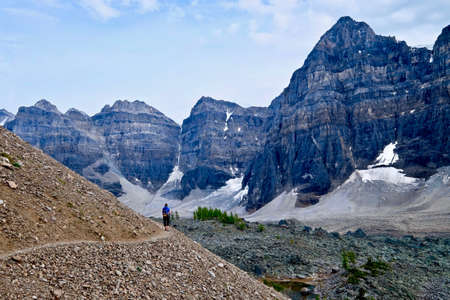 soloist: Woman hiker walking in rocky mountains. Hiking in Ten Peaks Valley. Banff National Park. Canadian Rockies. British Columbia. Canada.
