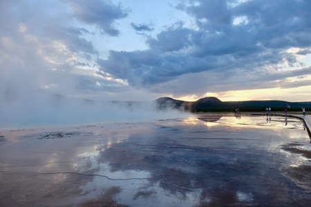 Yellowstone at sunset. Grand Prismatic Spring. Midway Geyser Basin. Yellowstone National Park. Jackson Hole. Wyoming. United States.
