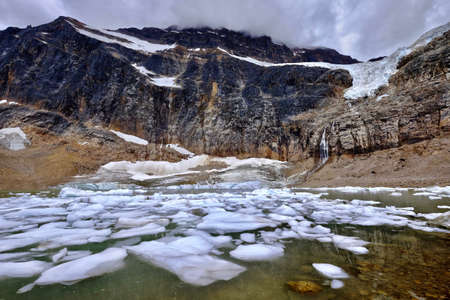 Glacier lake with ice. Angel Glacier at Mount Edith Cavell. Jasper National Park. Canadian Rockies. Alberta. Canada. Stock Photo