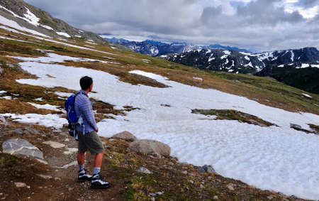 independance: Young man hiking in Colorado Mountains near Independance Pass. Aspen. Colorado. United States.