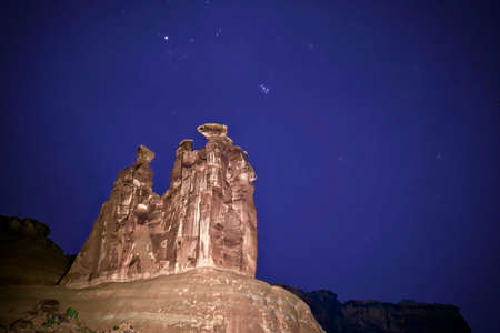 Starry sky over rocks. The Three Gossips  Rock in Arches National Park. Moab. Salt Lake City. Utah. United States.