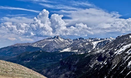White clouds over mountain peaks. Rocky Mountains National Park. Denver. Colorado. United States.