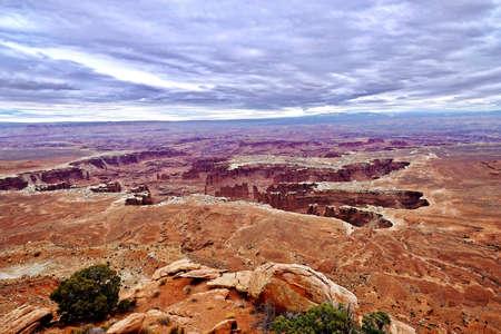 Canyon and hoodoos under storm sky. Canyonlands National Park. Moab. Utah. United States. Stock Photo
