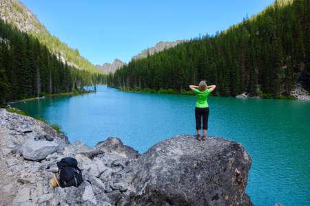 Woman hiker by alpine blue lake. Nada Lake. The Enchantments. Seattle. Leavenworth. WA. United States.