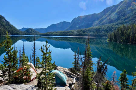 Camping tents near lake  in Cascade Mountains.  Snow Lake in The Enchantment Lakes basin near Leavenworth and Seattle. WA. USA.