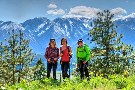 tacoma: Group of friends hiking in mountains. Cascade Mountains. Sauers Mountain trail near Leavenworth. Seattle. Washington. The United States. Stock Photo