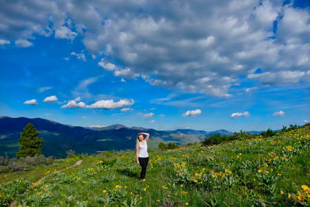 Happy smiling woman hiking in meadows.  Patterson Mountain. North Cascades National Park. Winthrop. Seattle. Washington. United States. Stock Photo