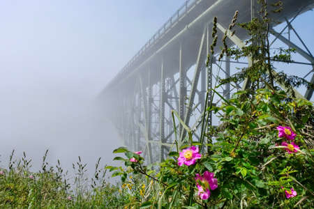 Deception Pass Bridge in fog. Arch bridge. Deception Pass State Park. Puget Sound. Juan de Fuca Strait. Whidbey Island. Seattle. Washington. United States.