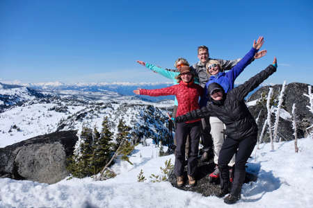 Successfull group of friends on mountain top. Cascade Mountains summit. Icicle Ridge trail near Seattle and Leavenworth. Washington. United States.