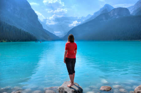 Woman hiker by lake Louise. Banff National Park. Alberta. Canada