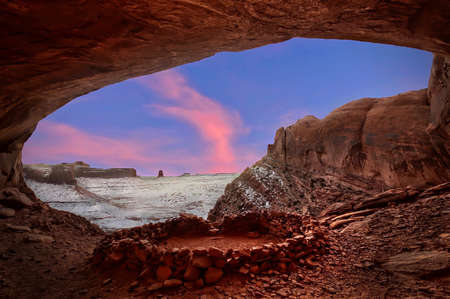 Indian spiritual place False Kiva in sandstone alcove with canyon view in winter. Sunset at Canyonlands National Park. Moab. Utah. United States. Stock Photo