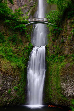 Bridge over waterfall  Multnomah Falls in summer. Beautiful waterfalls near Portland. Second highest year-round waterfall in the US. Oregon. United States of America.