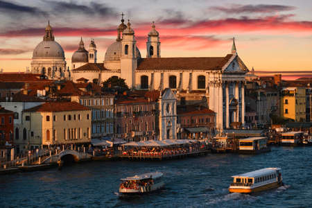 Venice skyline at sunset. Historical buildings and boats  in canal. Venice. Italy.