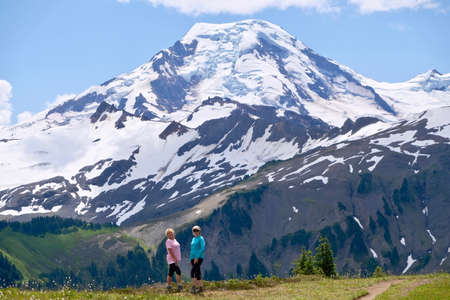 Obese women trying to loose weight hiking in mountains. Mount Baker National Forest. Washigton State. USA