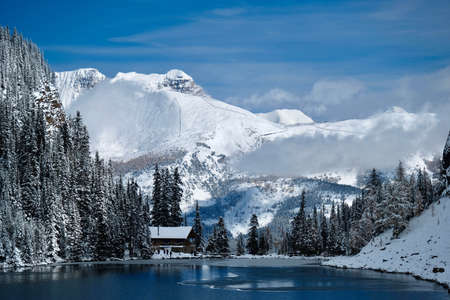 Tea House  at Lake Agnes in mountains covered with snow by blue alpine lake. Lake Louise area in Banff National Park. Canadian Rockies.  Alberta. Canada