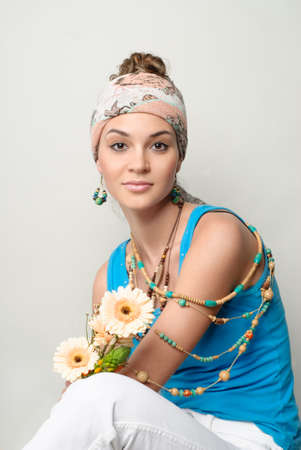 feminity: Young beautiful girl portrait  Flowers, turban and bijouterie Stock Photo