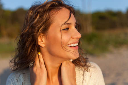 Beautiful curly girl is smiling  Outdoor shoot Stock Photo
