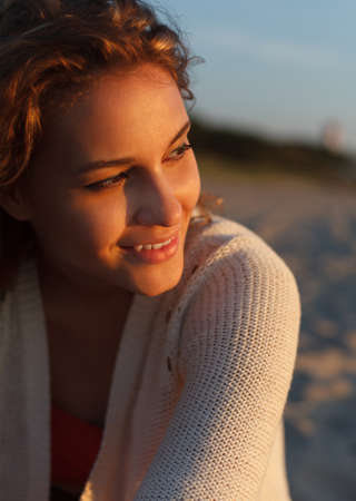 joyless: Beautiful curly girl is smiling  Outdoor shoot Stock Photo