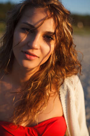 joyless: Beautiful curly girl is smiling  Outdoor shoot, sunset