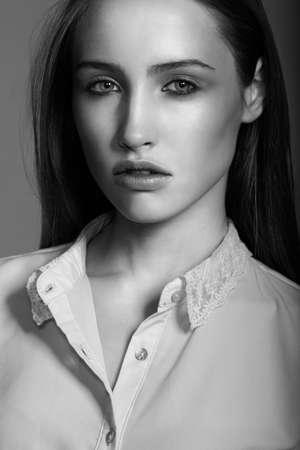 Sensual model is posing. Studio shot. Black and white photo